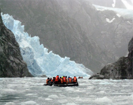 Visitors get up close and personal with a glacier in an ice field in Patagonia